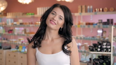 Portrait of beautiful shopaholic sexy woman inside a store Stock Footage