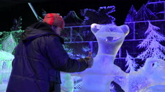 Wizard to create ice figures to work on another sculpture cartoon hero Ice Age Stock Footage