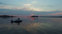 Fishing motor boat at dawn. Aerial view. Stock Footage