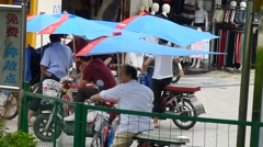 Shenzhen, China: electric bicycle soliciting illegal Stock Footage