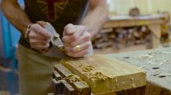 A woodworker works cutting wood in his studio. Stock Footage