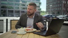 Businessman gets stomach ache during lunch, steadicam. Stock Footage