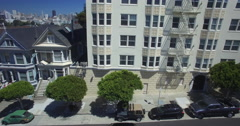 Aerial reveal of Painted Ladies houses in Alamo Square Stock Footage