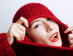 Young pretty woman in sweater and scarf all over her face, winter cold close up Stock Photos