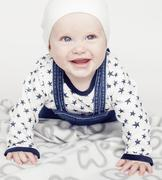 Little cute baby toddler on carpet isolated close up smiling adorable Kuvituskuvat