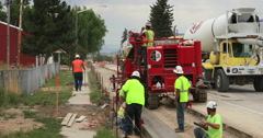 Cement truck construction road curb gutter DCI 4K Stock Footage