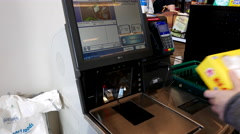 Close up of woman paying foods at self-check out counter Stock Footage