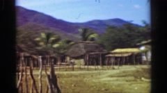 1952: Tropical climate farming village straw hut home buildings.   ACAPULCO, Stock Footage