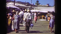 1952: Busy Mexican street market man carrying water on head sack of grain. Stock Footage