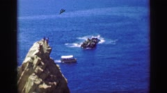 1952: Cliff divers jump La Quebrada El Mirador Hotel dangerous deadly stunt. Stock Footage