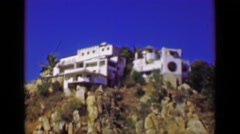 1952: Boat tour fancy wealthy tropical cliff ocean view villas mansions homes.   Stock Footage