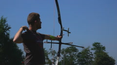 Target Archery: Young Archer Practice in Field Stock Footage