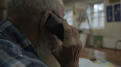The old man speaks on the phone Stock Footage