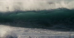 Blue waves roll into the coast of Hawaii in slow motion during a big storm. Stock Footage