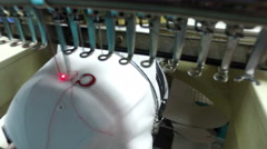 Industrial Embroidery Machine Embroidering Hat Stock Footage