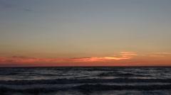 Waves on sandy beach at sunset. Italian coastline. Stock Footage