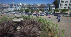 Aerial of AlamoSquare from the fountain to over the Painted Ladies Stock Footage
