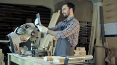 Carpenter makes selfie near woodworking machines in carpentry shop Stock Footage
