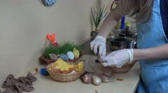 Using rice and onion shells to paint easter eggs Stock Footage