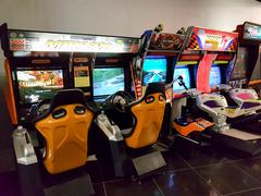 Vintage arcade gaming machines in the mall. Stock Photos