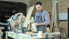 Professional carpenter at work measuring wooden planks.Timelaps Stock Footage