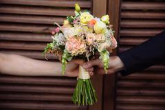 Wedding bouquet in marriage couple hands Stock Photos