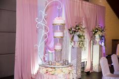Sweet multilevel wedding cake invwrted top to bottom design Stock Photos