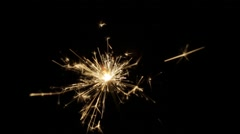 Burning sparkler or bengal light in darkness Stock Footage