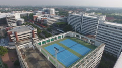 Aerial rooftop tennis court 4k Stock Footage
