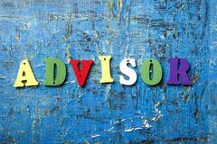 The word of ADVISOR on colorful abc letters at abstract blue background Kuvituskuvat