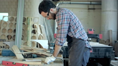 Young carpenter working with electric machine in the workshop Stock Footage