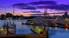 4K Sunset Victoria BC Canada Harbour, Purple Sky and Moored Boats at Dock Stock Footage