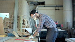 Bearded carpenter working with electric planer on wooden plank in workshop Stock Footage