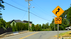 4K Road Sign, Curve Winding Road Yellow Traffic Sign Warning Stock Footage