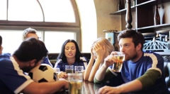 Soccer fans watching football match at bar or pub Stock Footage
