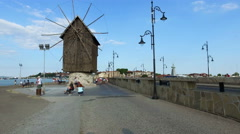 Windmill at entrance of Old town of Nessebar Stock Footage