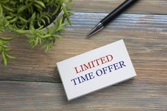 Text Limited time offer on white paper book and office supplies wood desk Stock Photos