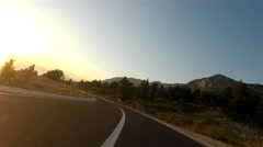 Motorcycle driving at sunset Stock Footage