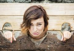 Young caucasian woman in medieval pillory Stock Photos