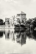 Beautiful castle in Tata, Hungary, travel destination, black and white Stock Photos