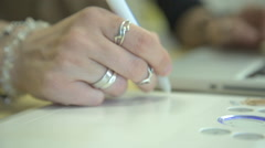 It is close-up image of woman hand drawing using graphic tablet Stock Footage