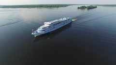 White  tourist vessel sailing along the river on a summer day. Aerial view. Stock Footage