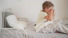Child girl wakes up from sleep.A nice child girl enjoys sunny morning. Good Stock Footage