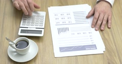 Businessman checking financial reports Stock Footage