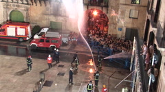 Fire brigade spraying water on crowd for fun Stock Footage