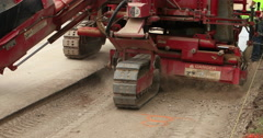 Construction machine lays concrete curb gutter DCI 4K Stock Footage