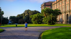 Jogging in the park Outside of Royal Palace of Capodimonte, Naples Italy Stock Footage