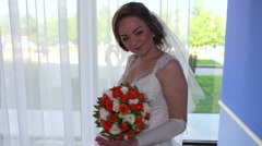 Bride turns the bouquet Stock Footage