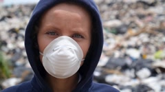 Woman in Mask Looking in Camera on Garbage Dump. Pollution, Ecological Disaster Stock Footage
