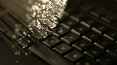 Typing on keyboard with Fiber optics background, shot in HD Stock Footage